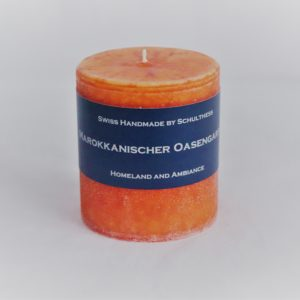 Handicraft scented candle by Schulthess Kerzen from Switzerland. Orange color with warm, floral and aromatic scent