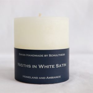 Handicraft scented candle by Schulthess Kerzen from Switzerland. White color with soft and woody scent
